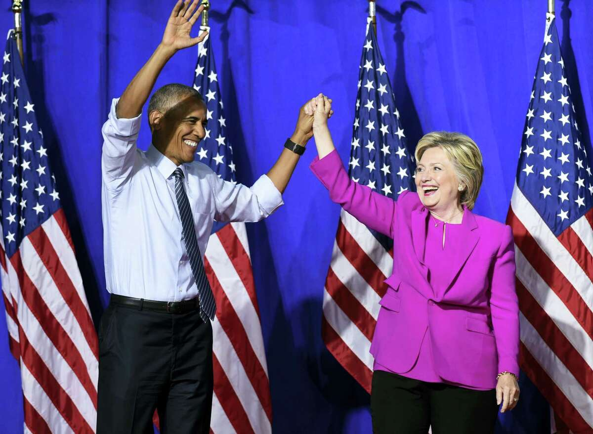 President Barack Obama and Democratic presidential candidate Hillary Clinton arrive at a campaign event at the Charlotte Convention Center in Charlotte, N.C., Tuesday, July 5, 2016. Obama is spending the afternoon campaigning for Clinton.