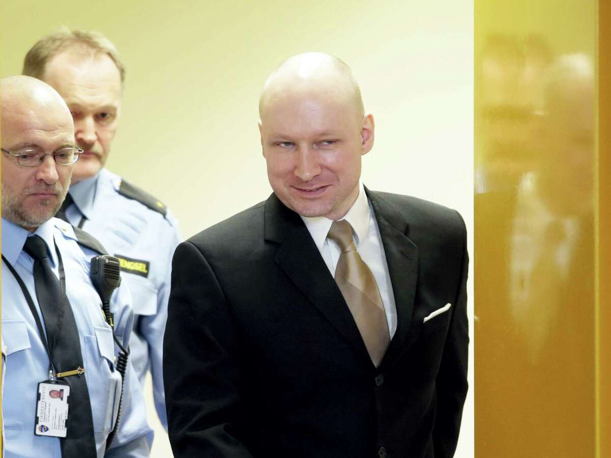 In this Tuesday, March 15, 2016, file photo of Anders Behring Breivik enters a courtroom in Skien, Norway. A court ruled on Wednesday April 20, 2016 that Breivik's human rights have been violated during his imprisonment for terrorism and mass murder.