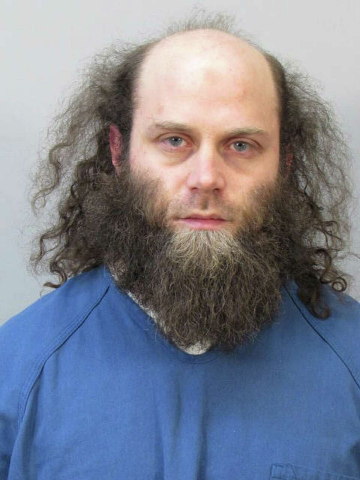 In this photo provided by the Dane County Sheriff's Office, Joshua Van Haften, 34, appears as he is booked Wednesday, April 8, 2015, in Madison, Wisc. Van Haften, accused of traveling to Turkey as part of a failed attempt to join the Islamic State in Syria, was ordered held without bond Thursday for trying to aid a terrorist group.