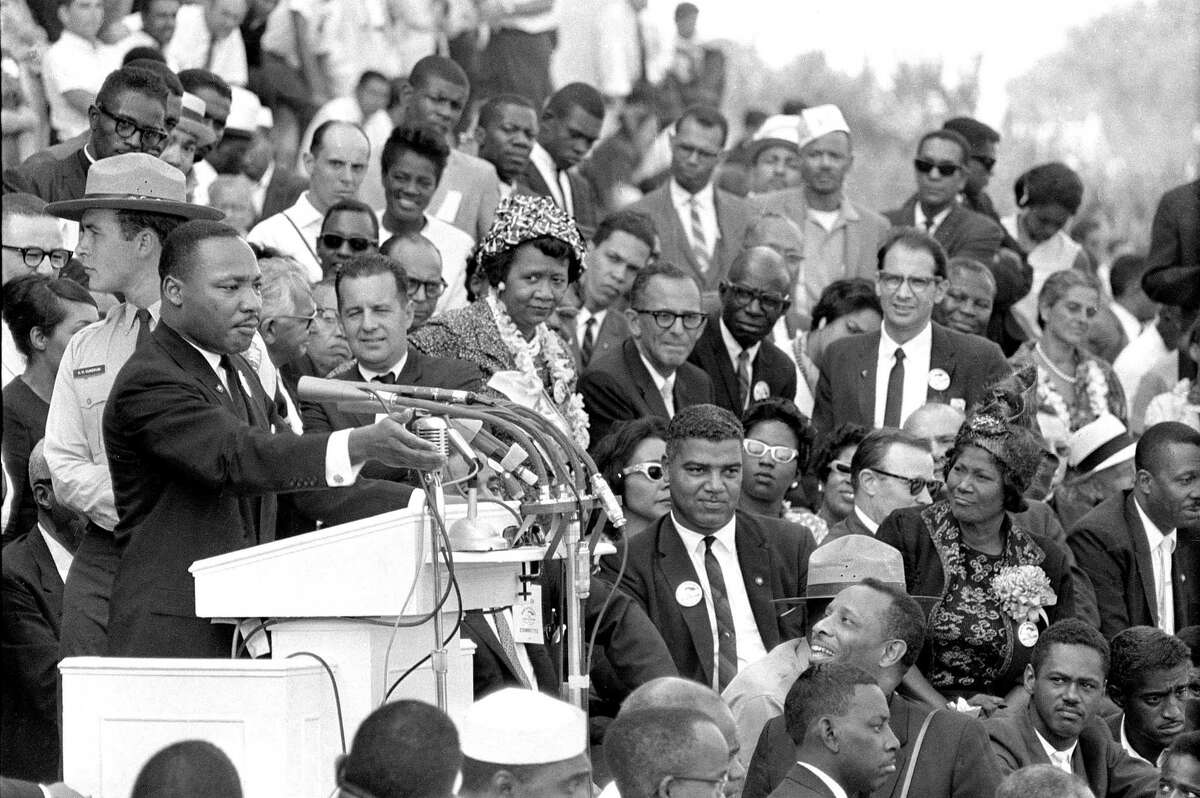 """In this Aug. 28, 1963, photo, the Rev. Dr. Martin Luther King Jr., head of the Southern Christian Leadership Conference, gestures during his """"I Have a Dream"""" speech as he addresses thousands of civil rights supporters gathered in Washington, D.C. Months before the Rev. Martin Luther King Jr. delivered his famous """"I Have a Dream"""" speech to hundreds of thousands of people, he fine-tuned his civil rights message before a much smaller audience in North Carolina. Reporters had covered King's 55-minute speech at a high school gymnasium in Rocky Mount on Nov. 27, 1962, but a recording was not known to exist until English professor Jason Miller found an aging reel-to-reel tape in the town's public library."""