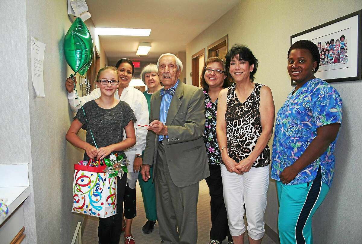 The Children's Dental Center at Brooker Memorial recorded its 120,000th patient visit Aug. 25, 2014. Katelyn Wilcox, 13, of Torrington was greeted by clinic founder Dr. Isadore Temkin and Brooker staff and told about her special visit.