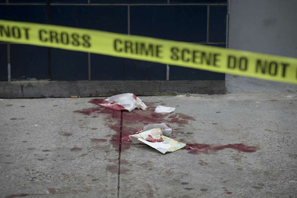 Blood stains the pavement near 1 OAK nightclub on West 20th Street, in New York, where authorities say Indiana Pacers forward Chris Copeland, his wife and another woman were stabbed outside after an argument on April 8, 2015.