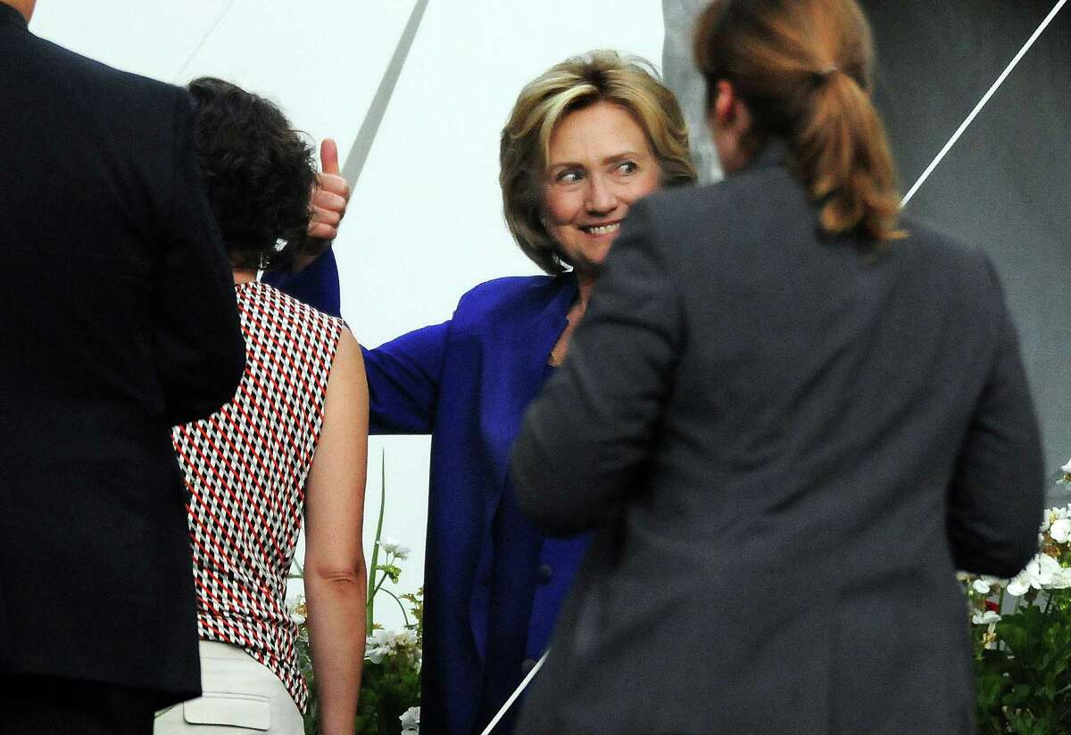 Presidential candidate Hillary Rodham Clinton gestures with a smile after speaking during a private fundraiser at the home of longtime supporter Virginia McGregor in the Green Ridge section of Scranton, Pa., on Wednesday, July 29, 2015. The event was closed to the media.