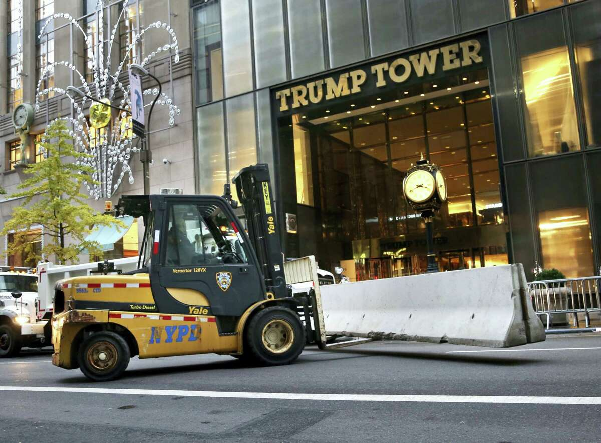In this file photo, police officers help to install concrete barriers around Trump Tower, the home of President-elect Donald Trump, in New York.