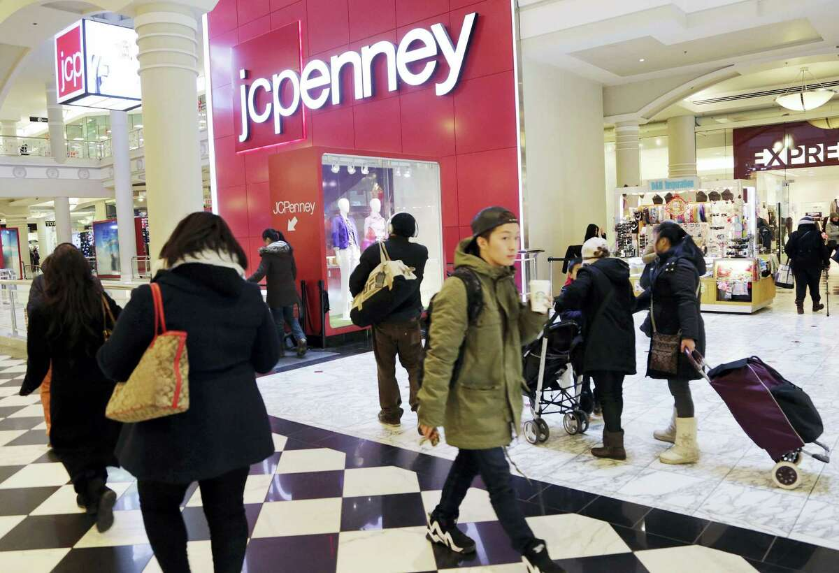 In this file photo, shoppers visit a J.C. Penney store in New York.