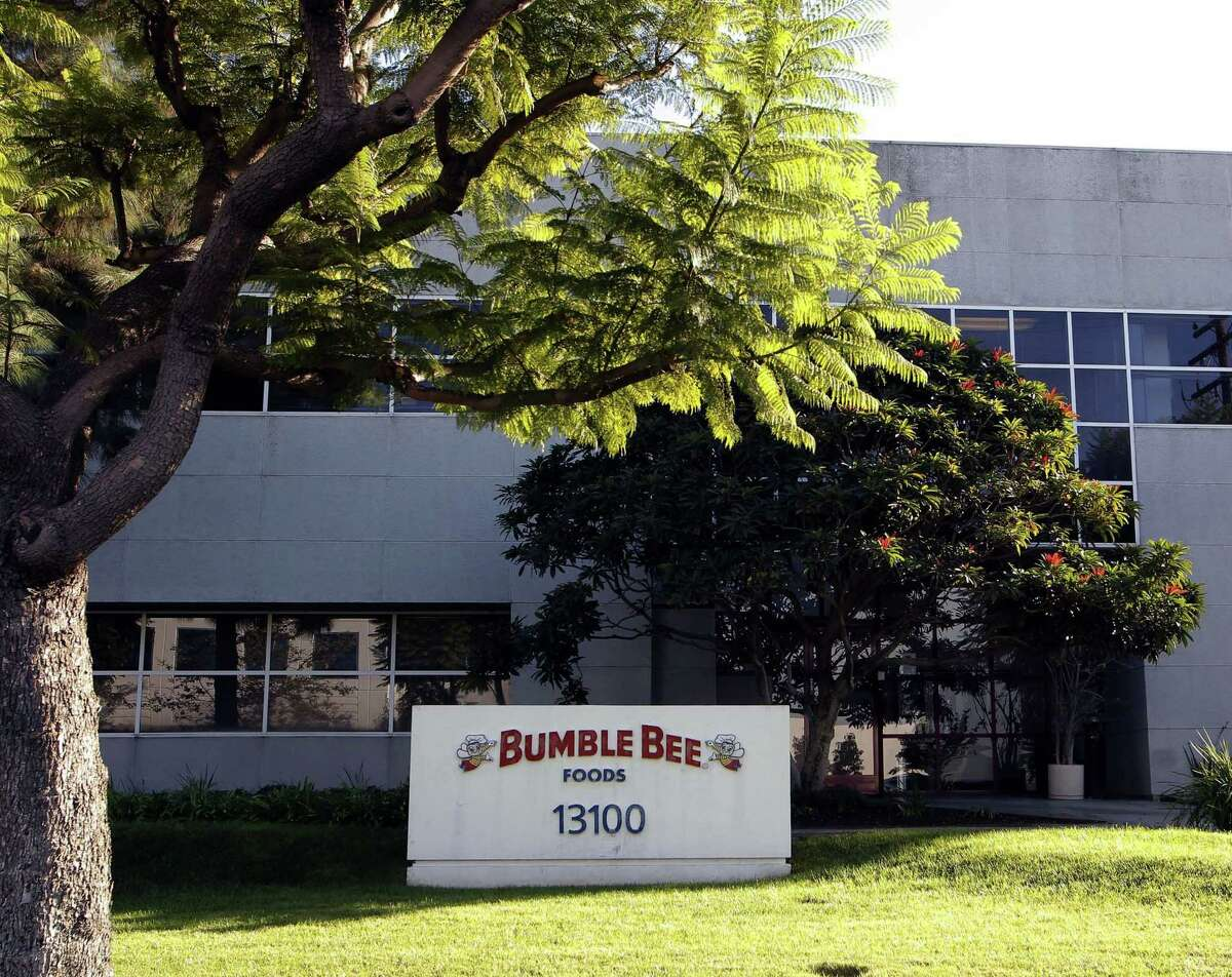 This Monday, Oct. 15, 2012, file photo shows the Bumble Bee tuna processing plant in Santa Fe Springs, Calif. Bumble Bee Foods has agreed to pay $6 million Wednesday, Aug. 12, 2015, to settle criminal charges in the death of a Los Angeles-area worker who was cooked in an oven with tons of tuna.