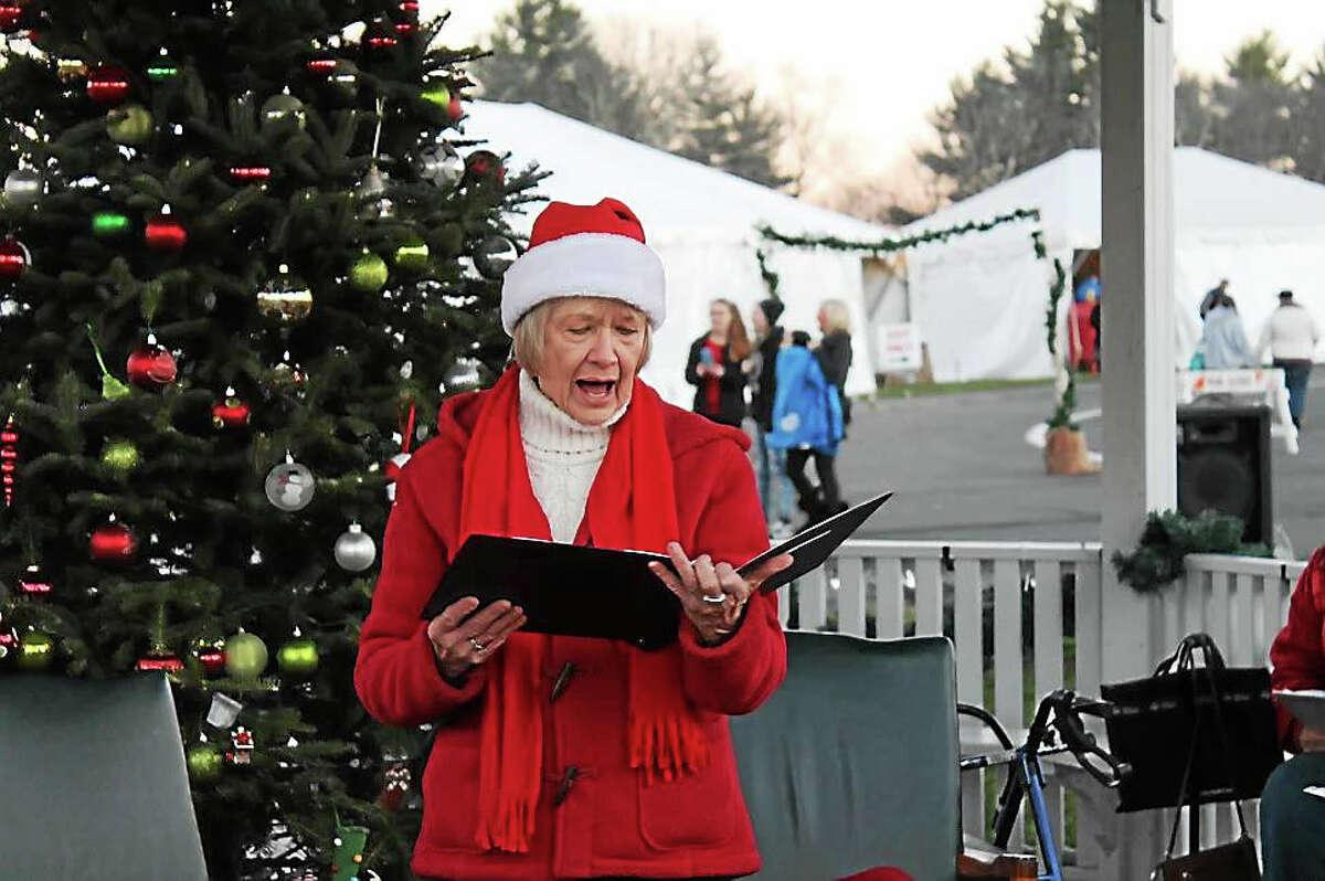 "Sharlene Copeland, director of the Harwinton Senior Center, leads the ""Harwintones"" in singing Christmas Carols to start off the Harwinton Hometown Holiday Celebration."