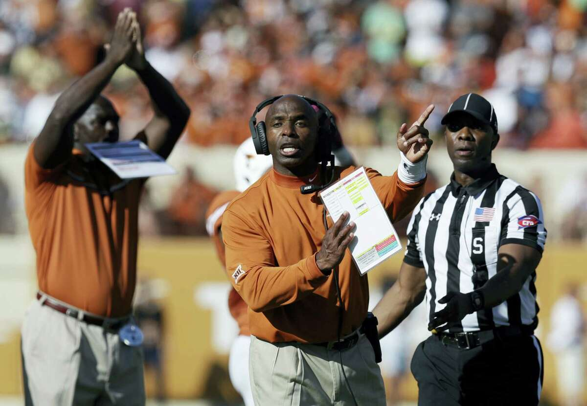 In this Oct. 29, 2016 photo, Texas coach Charlie Strong signals to officials during the team's NCAA college football game against Baylor in Austin, Texas. Texas plays West Virginia in Austin this week.