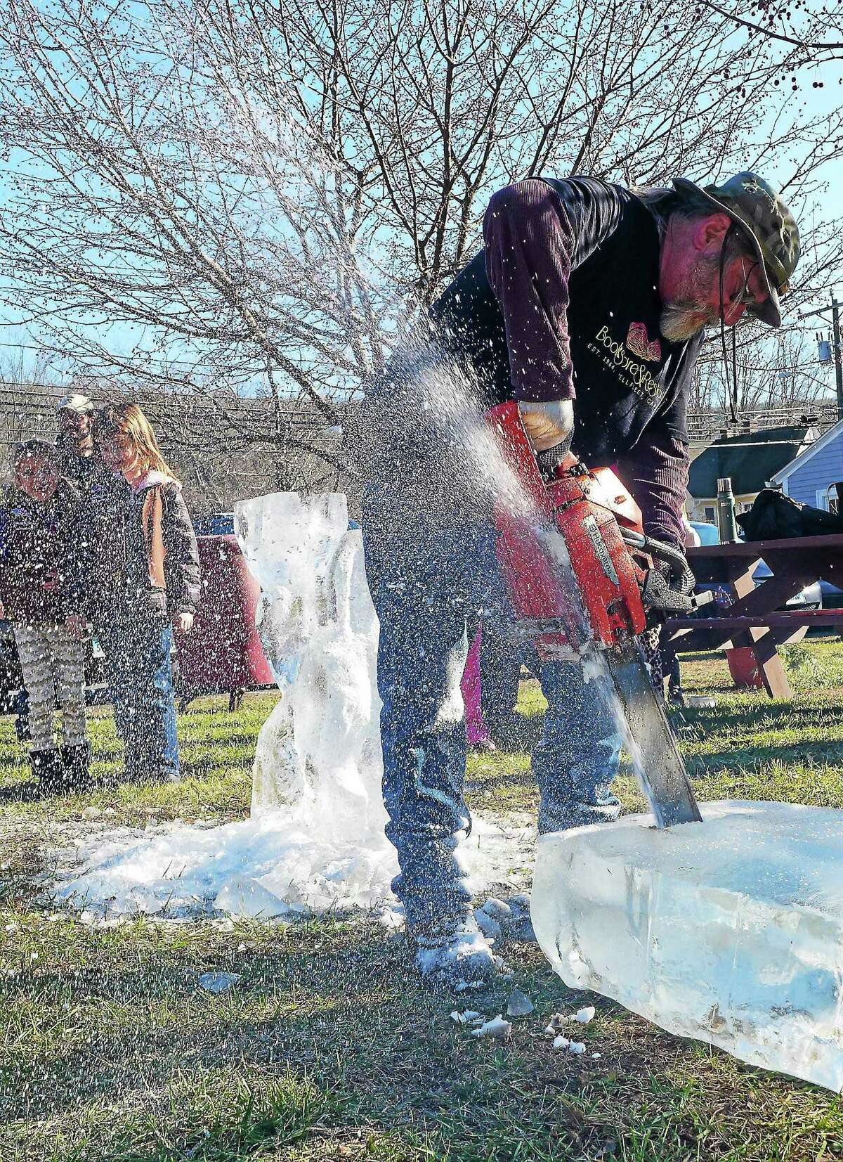 Photo by John Fitts Zejke Hermann, of Cornwall, works on his reindeer and sled carving at Christmas in Riverton on Saturday.