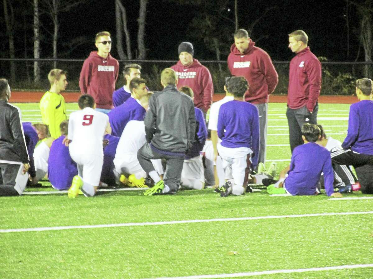 Photo by Peter Wallace Torrington Coach Mike Fritch (second from right) talks to his team after a boys soccer Class L second-round loss to Wethersfield Thursday night at the Robert H. Frost Sports Complex.