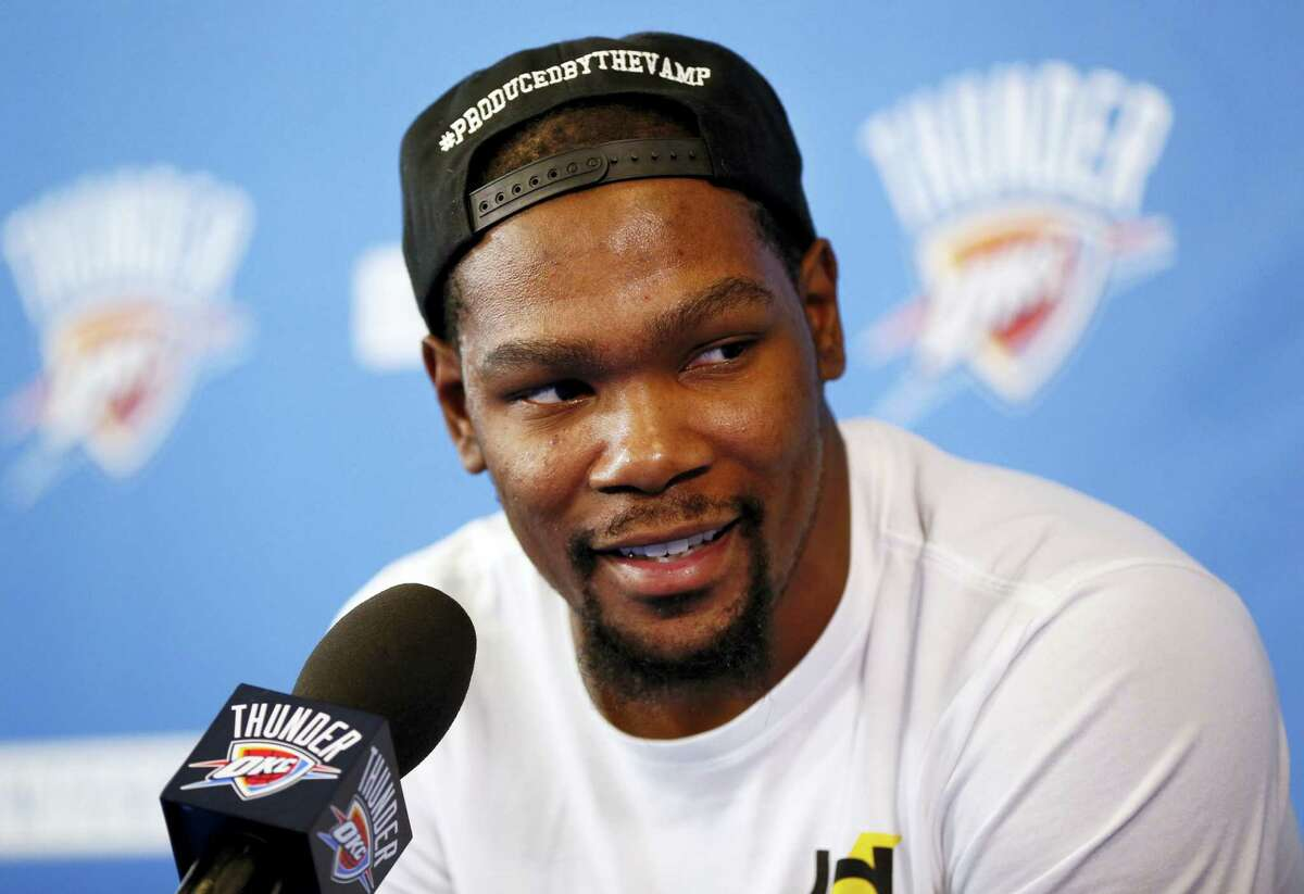 In a Wednesday, June 1, 2016 file photo, Oklahoma City's Kevin Durant (35) speaks during a news conference at the team's practice facility in Oklahoma City. Durant announced Monday, July 4, 2016 that he is joining All-Stars Stephen Curry and Klay Thompson with the Golden State Warriors. Durant made the decision public on The Players'Äô Tribune Monday morning. He can'Äôt officially sign until July 7.