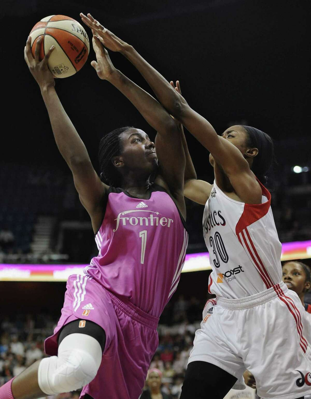 The Connecticut Sun's Elizabeth Williams shoots over the Washington Mystics' LaToya Sanders during Friday's game in Uncasville.