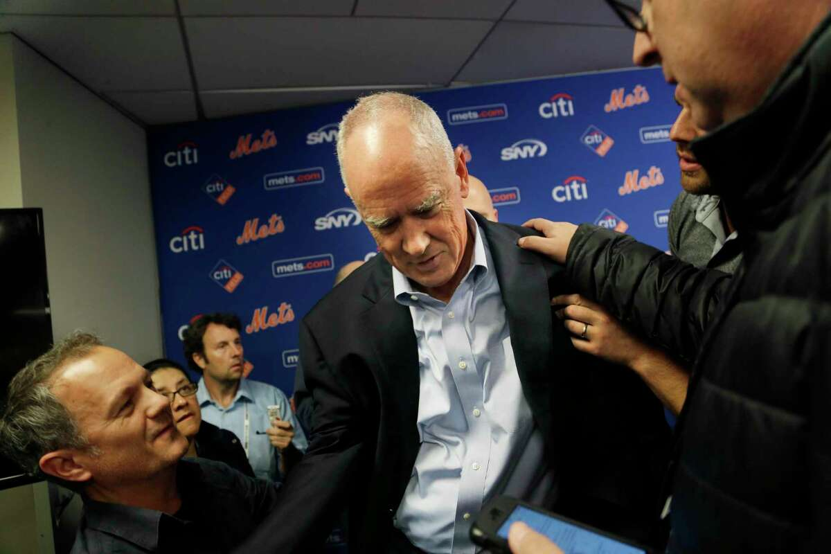 In this Nov. 4 file photo, New York Mets general manager Sandy Alderson is assisted to his feet by reporters after collapsing during a news conference in New York.