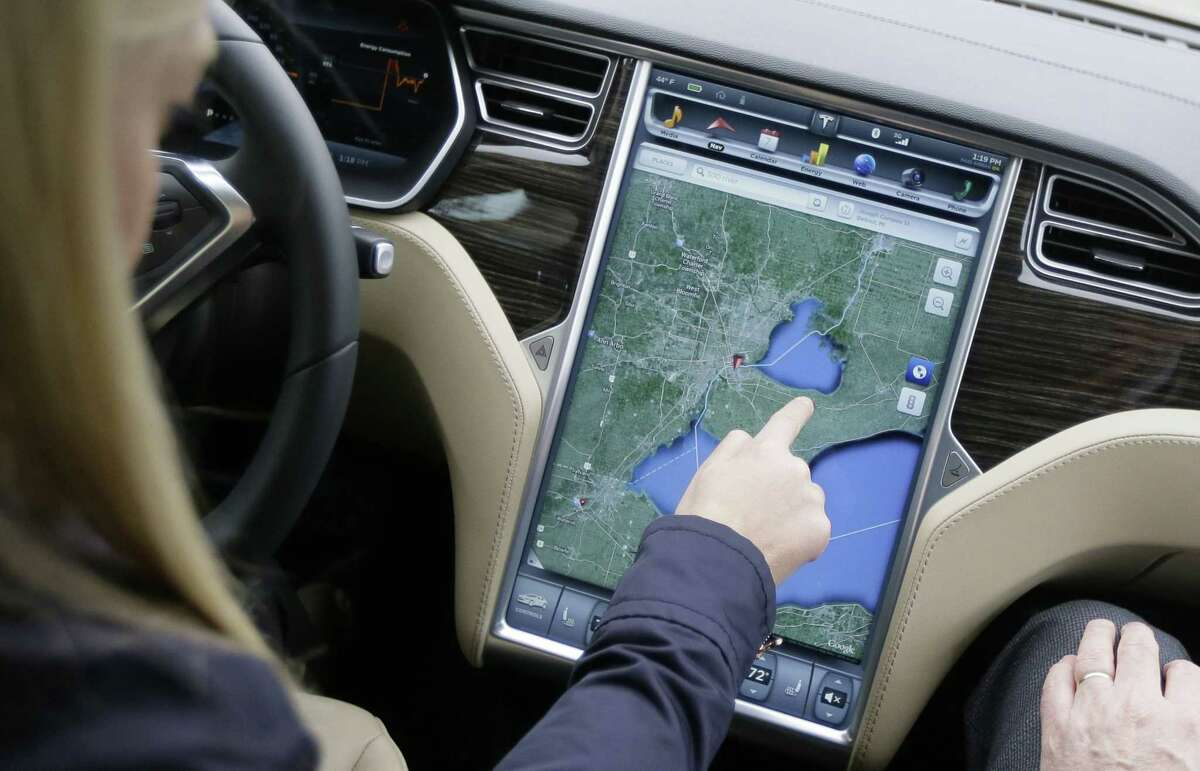 Alexis Georgeson of Tesla Motors shows off the navigation screen of the new Tesla Model S 70D during a test drive Tuesday in Detroit.