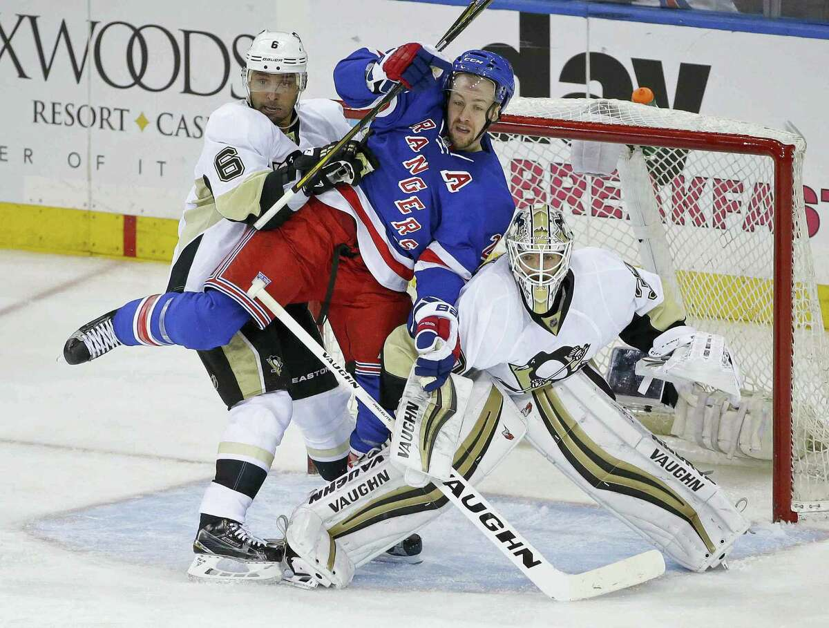 The Penguins' Trevor Daley (6) and Matt Murray (30) defend the goal as the Rangers' Derek Stepan fights for position during the third period on Tuesday.