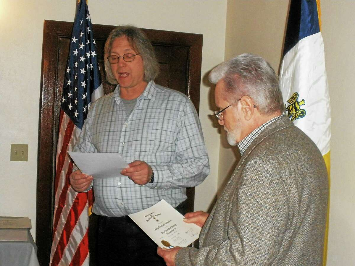 George Mills of Winsted and Arthur J. Dubois Jr. of Washington Depot become the newest members of the Sons of the American Revolution Gov. Oliver Wolcott Sr. Branch on Monday.