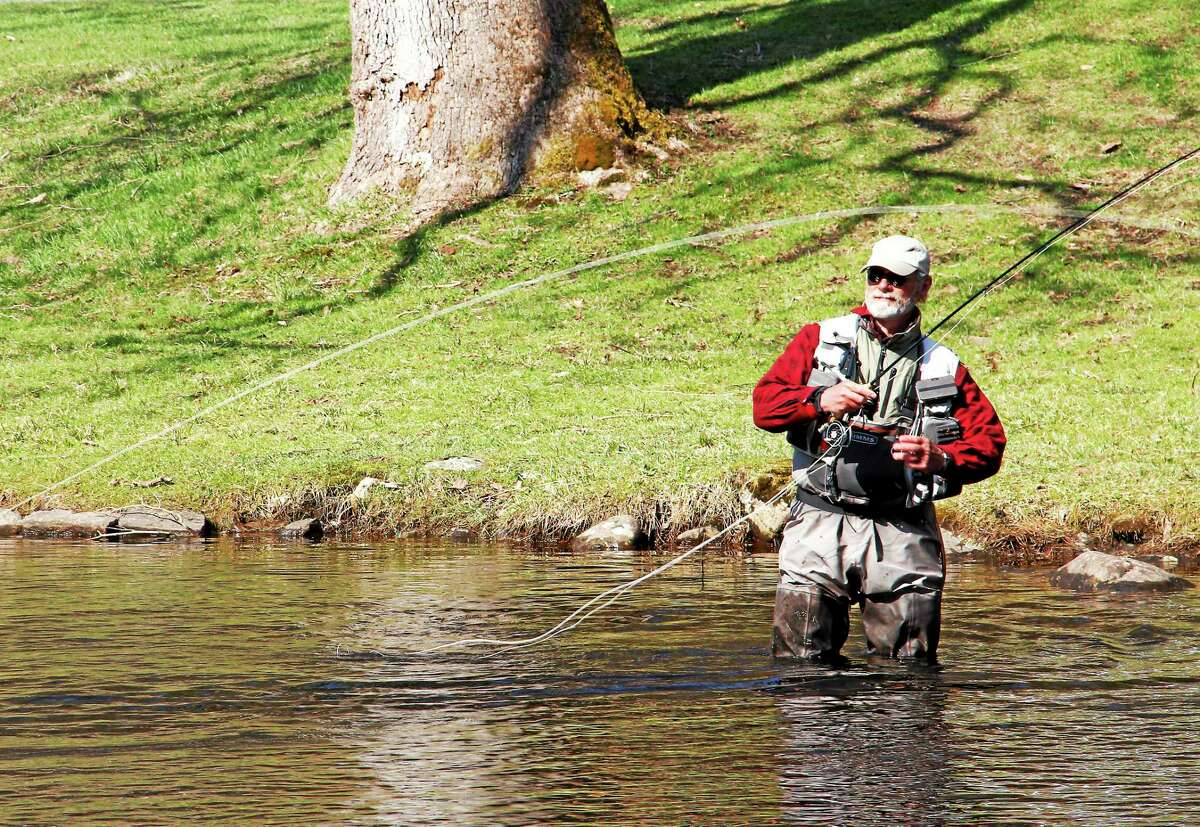A man fly fishing during the 2014 Riverton Fish Derby.