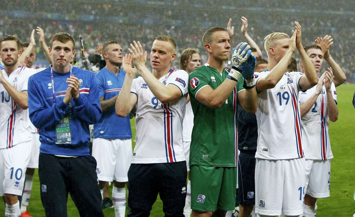 Iceland's players applaud supporters at the end of their match against France on Sunday.