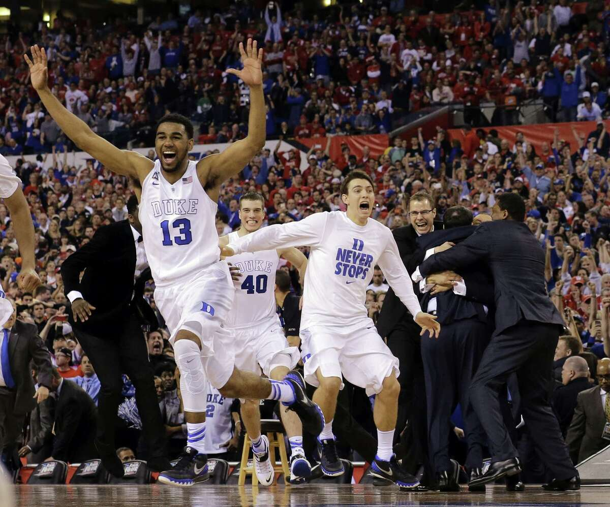Duke players celebrate after the NCAA Final Four college basketball tournament championship game against Wisconsin Monday, April 6, 2015, in Indianapolis. Duke won 68-63.