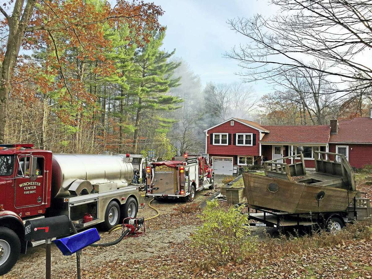 Ben Lambert - The Register CitizenWinchester firefighters respond to a barn fire at 109 Wahnee Road Thursday afternoon.