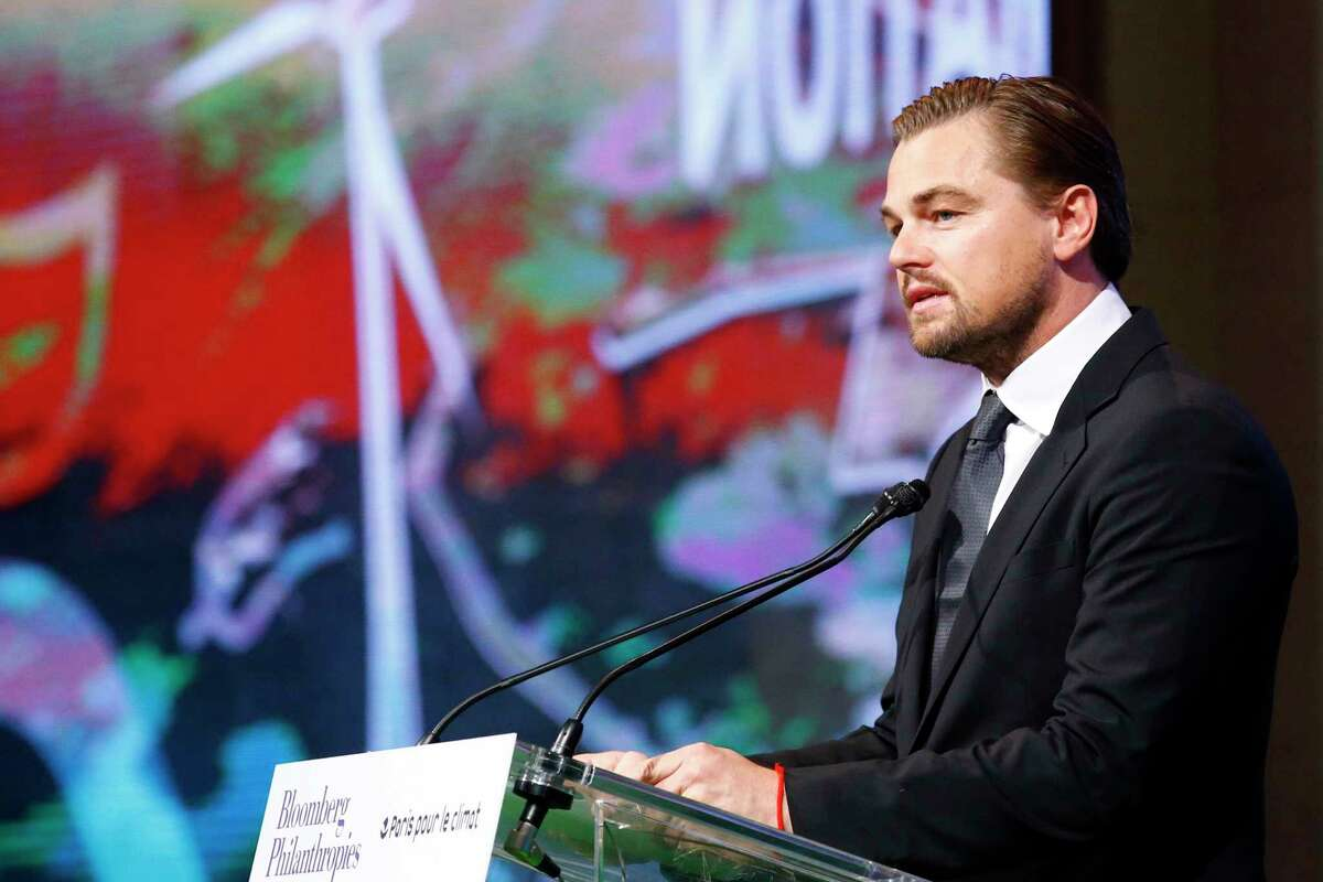 Leonardo DiCaprio adresses to the audience during a meeting with Mayors to push for local actions to fight climate change at Paris city Hall on the margins of the COP21, as part of the COP21, United Nations Climate Change Conference, in Paris, Friday, Dec. 4, 2015.