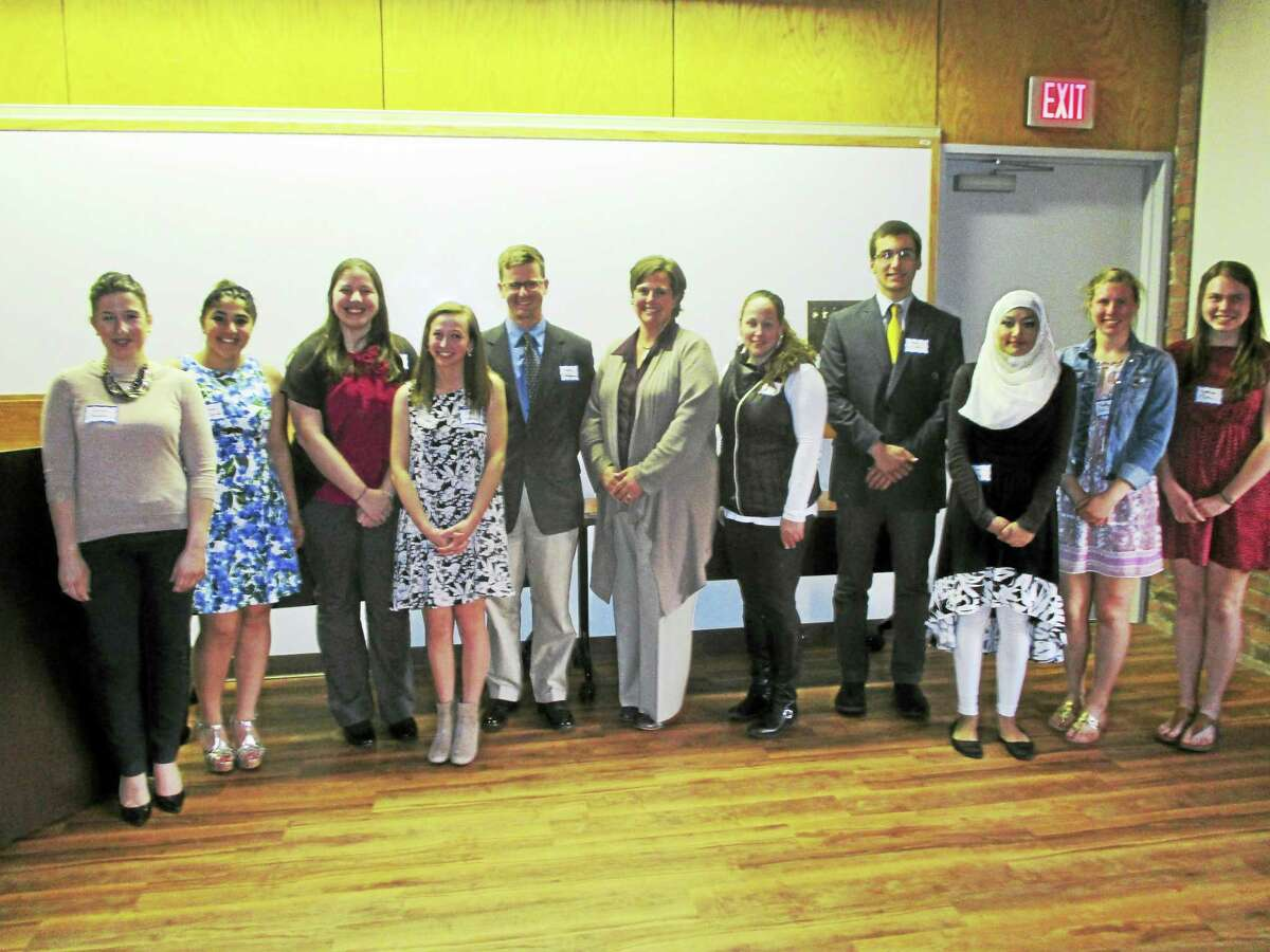 PHOTO CAPTION: CHH Auxiliary awards 12 local college bound students for the healthcare filed with $1,000 scholarships at their annual ceremony.