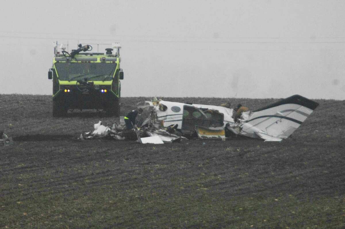 Investigators work at the site of a small plane crash Tuesday near Bloomington, Ill.