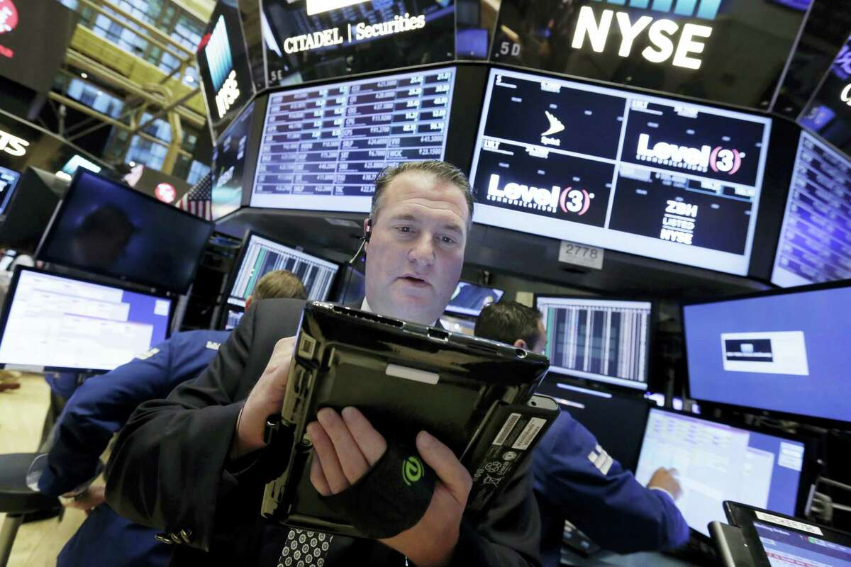 Trader Jonathan Corpina works on the floor of the New York Stock Exchange Tuesday.