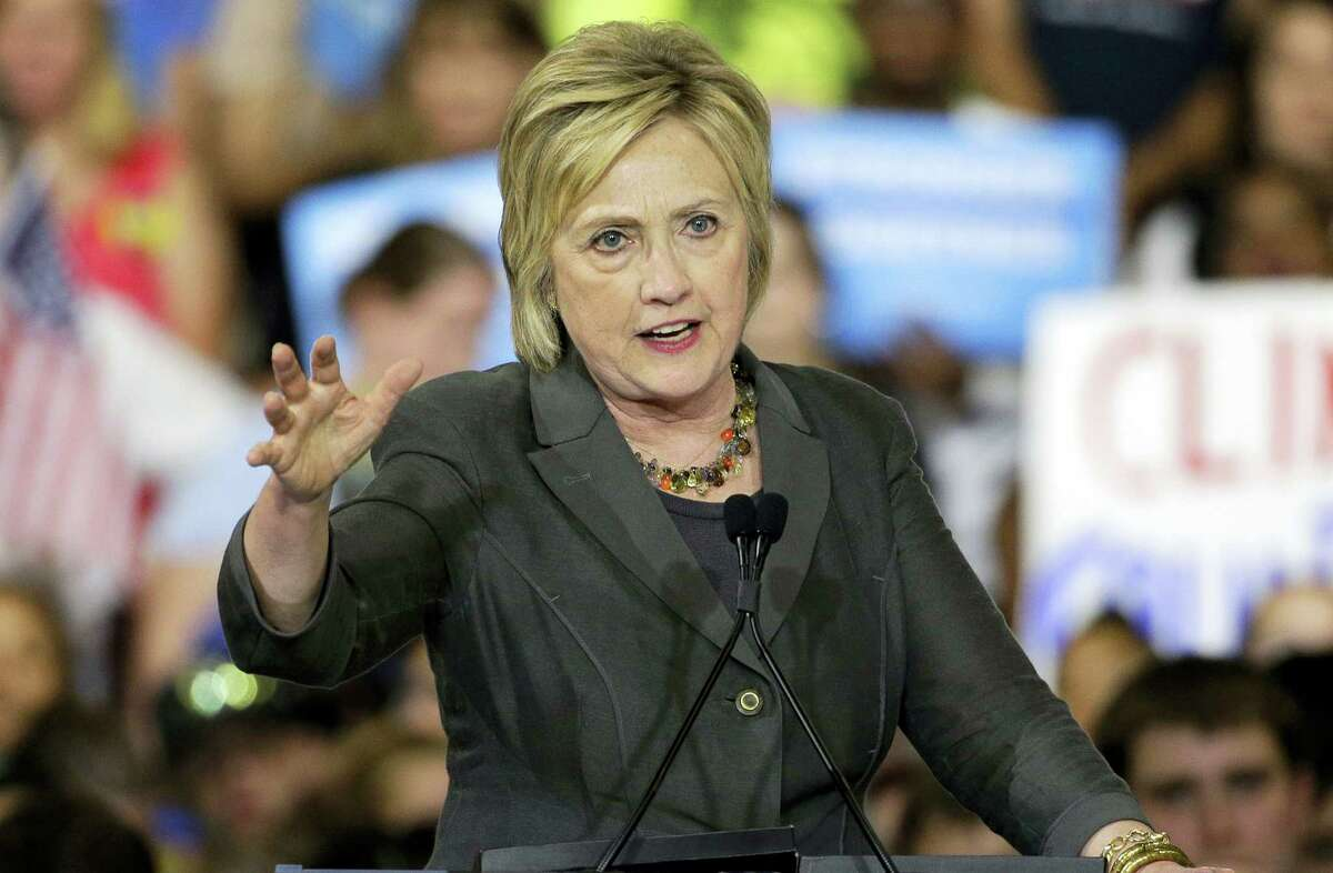 In this June 22, 2016 photo, Democratic presidential candidate Hillary Clinton gestures as she speaks during a rally in Raleigh, N.C.