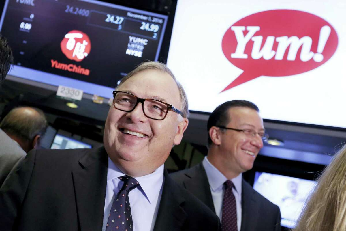 Yum! Brands CEO Greg Creed, left, visits the trading floor of the New York Stock Exchange, prior to ringing the opening bell, to mark the completion of the separation of Yum China Holdings Inc. from Yum! Brands Tuesday.