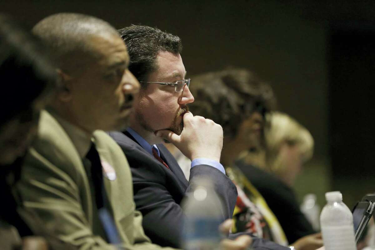 In this March 15, 2016 file photo, Ferguson Mayor James Knowles III listens during a city council meeting in Ferguson, Mo. St. Louis-area residents were sounding off Tuesday, April 19, 2016 in the last public hearing on the U.S. Department of Justice's settlement that calls for sweeping changes in Ferguson, where 18-year-old Michael Brown was fatally shot by a police officer.