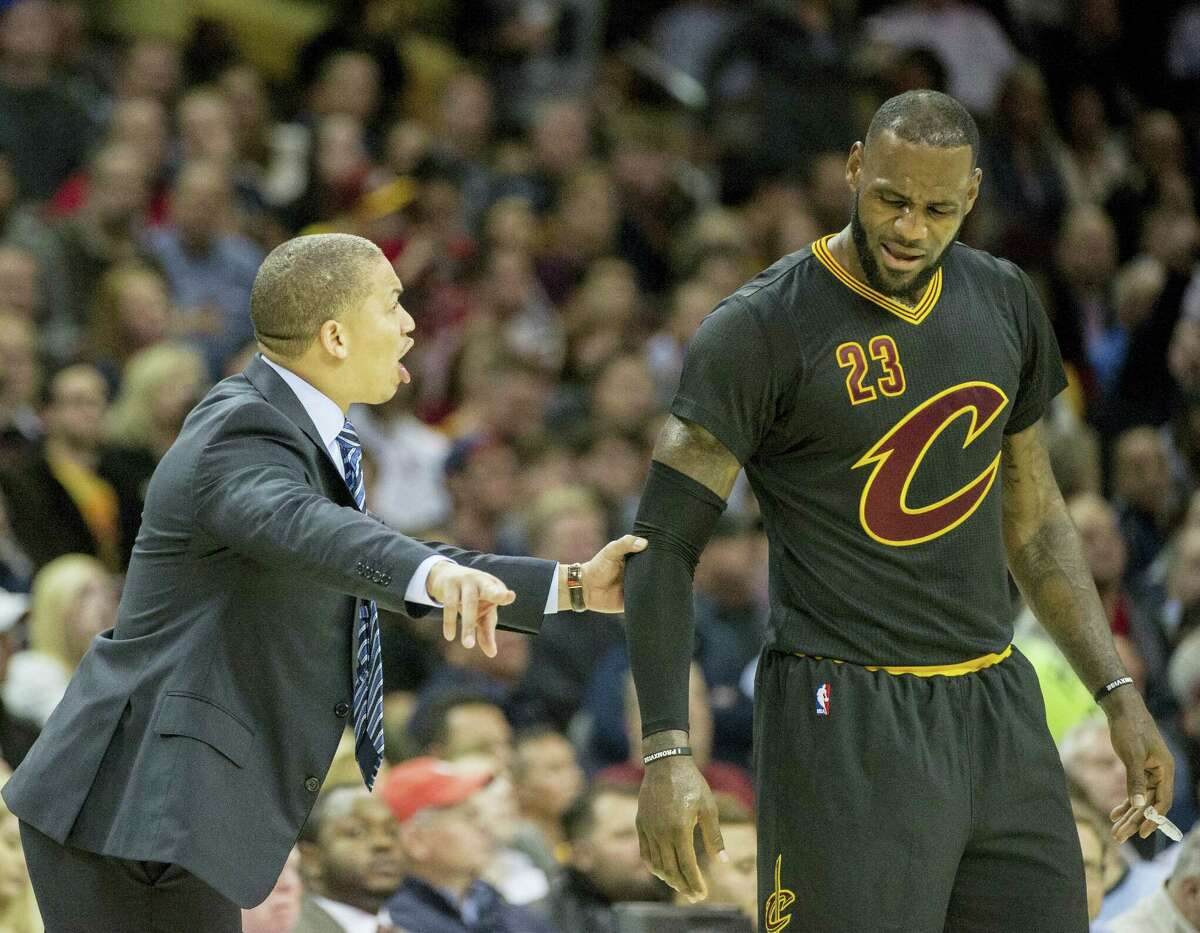 Cleveland Cavaliers head coach Tyronn Lue speaks with LeBron James during the second half of an NBA basketball game against the Atlanta Hawks in Cleveland on Tuesday, Nov. 8, 2016. The Hawks won 110-106.