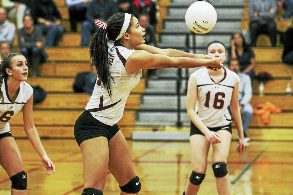 With a weapon at every position, Torrington's Carissa Carbone (6) and Lauren Gaghan (16) stand ready as Jolie Fox lofts a set in the Red Raiders' Class M second-round win over Weston.