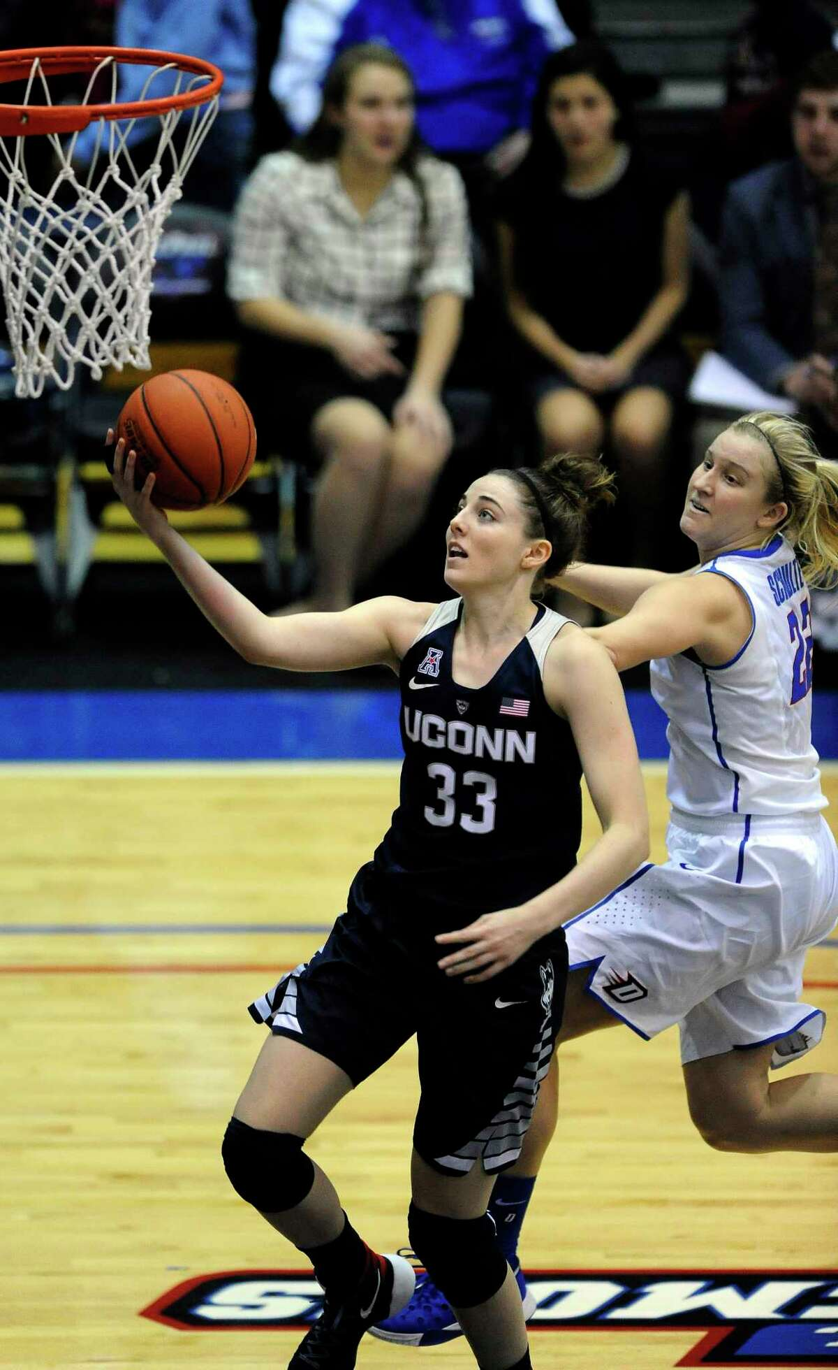 UConn freshman Katie Lou Samuelson goes up for a shot against DePaul's Brooke Schulte during the fourth quarter of the Huskies' 86-70 win Wednesday in Chicago.