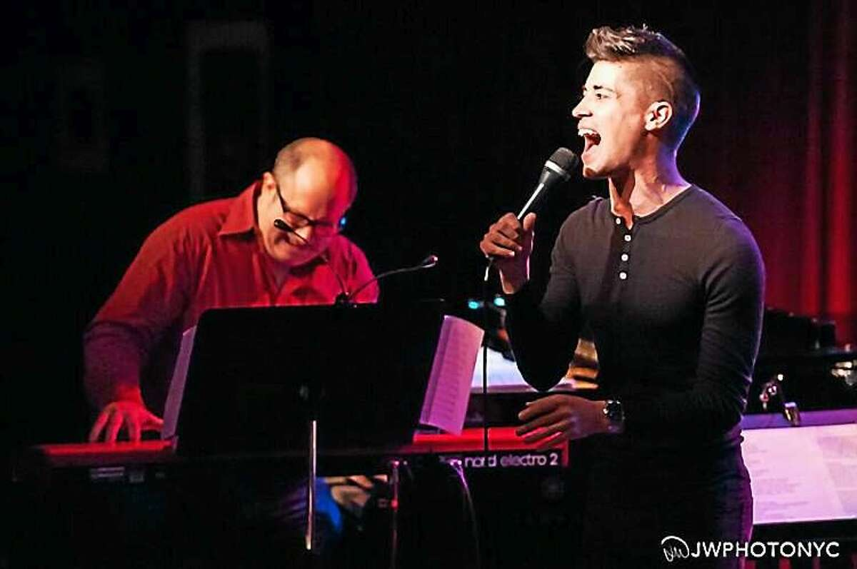 Contributed photos Trevor McQueen performs with James Sampliner.