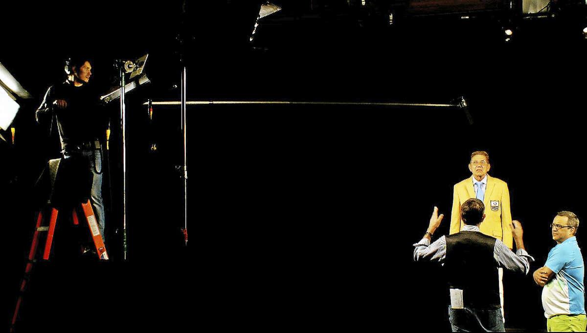 Joe Namath works with Immersive Artistry's Ed Jones and Jack Giarraputo during filming.