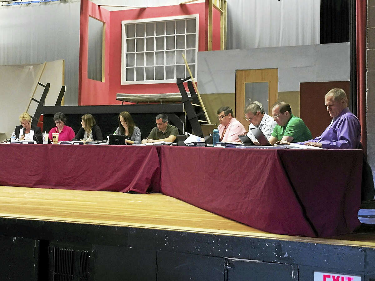 BEN LAMBERT — REGISTER CITIZEN The Board of Education voted Tuesday not to renew the contracts of dozens of non-tenured city educators.
