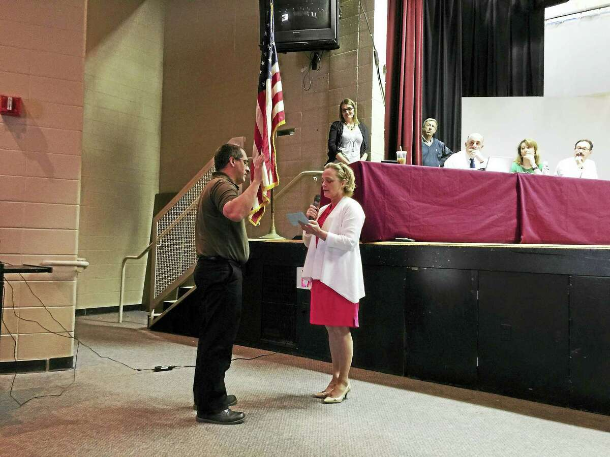 BEN LAMBERT — REGISTER CITIZEN Armand Maniccia is sworn-in as the newest member of the Torrington Board of Education Tuesday evening.