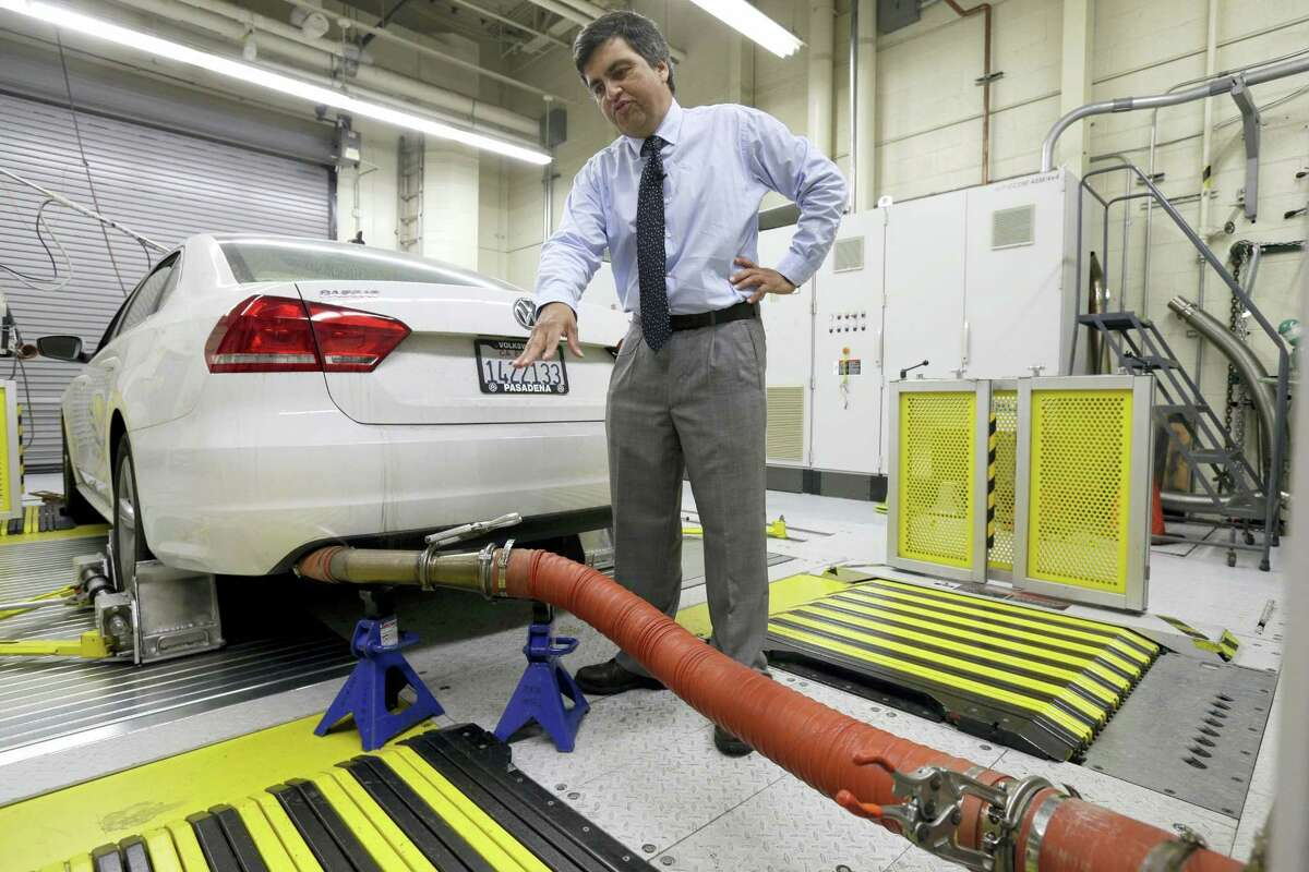 In this Sept. 30, 2015 photo, John Swanton, spokesman with the California Air Resources Board, explains how a 2013 Volkswagen Passat with a diesel engine is evaluated at the emissions test lab in El Monte, Calif. Lawyers for thousands of people who own diesel Volkswagens that cheat on emissions tests are asking a judge to order repairs and compensation if the company doesn't agree to a fix by Thursday, April 21, 2016.