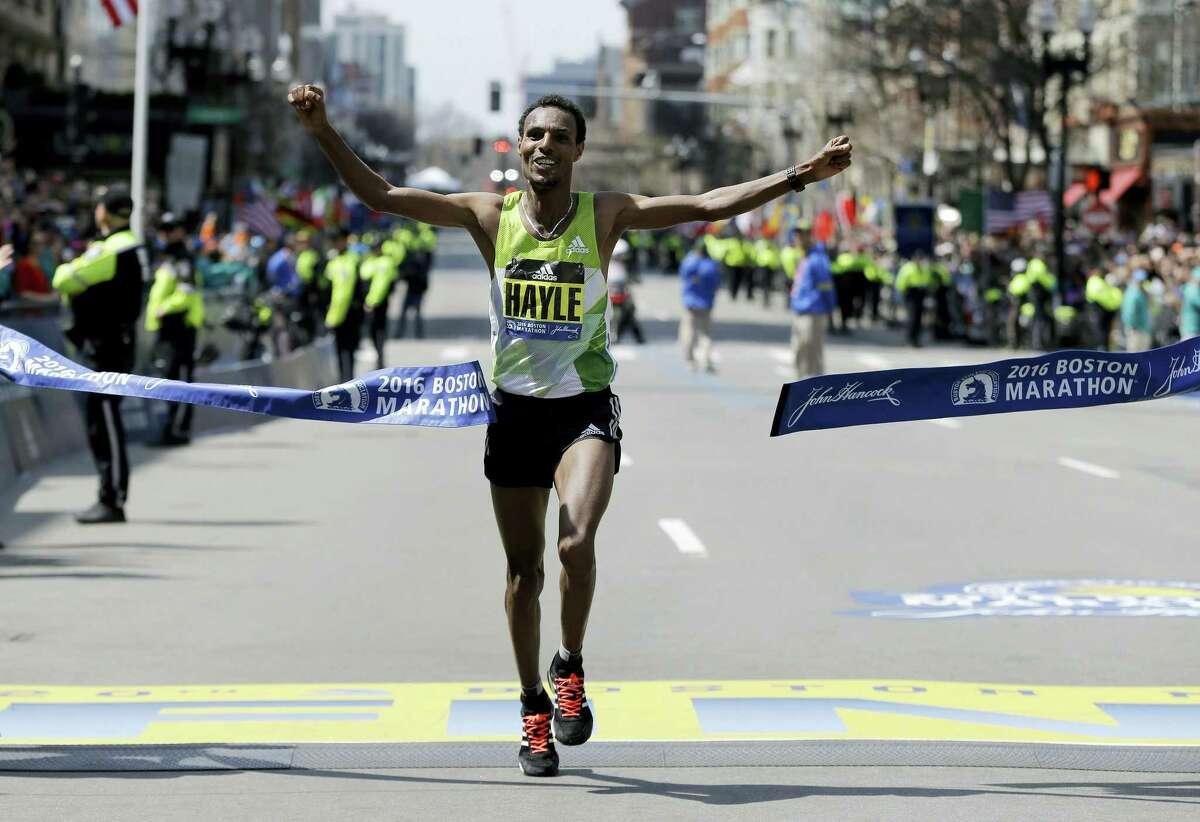 Lemi Berhanu Hayle, of Ethiopia, breaks the tape to win the 120th Boston Marathon on Monday in Boston.
