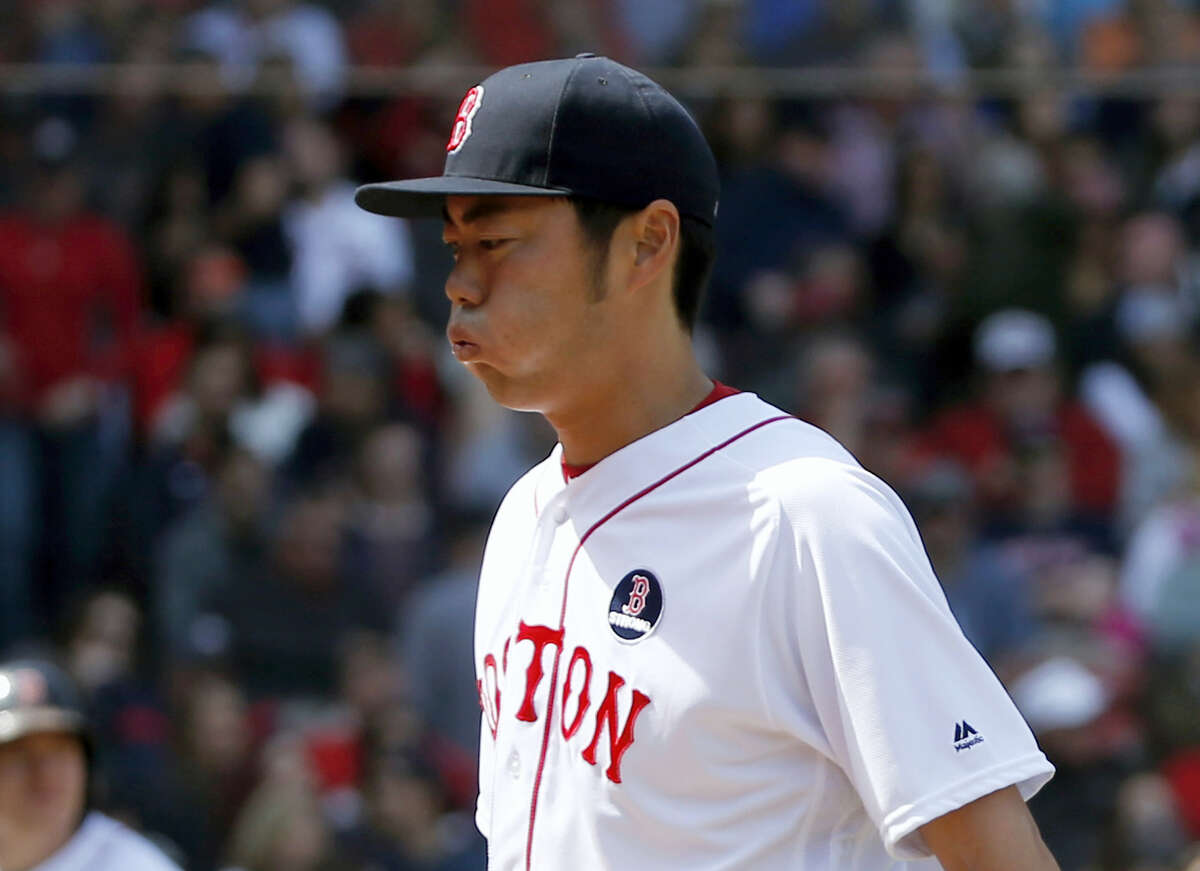 Boston Red Sox relief pitcher Koji Uehara reacts as he leaves the game with the bases loaded during the eighth inning against the Toronto Blue Jays Monday.