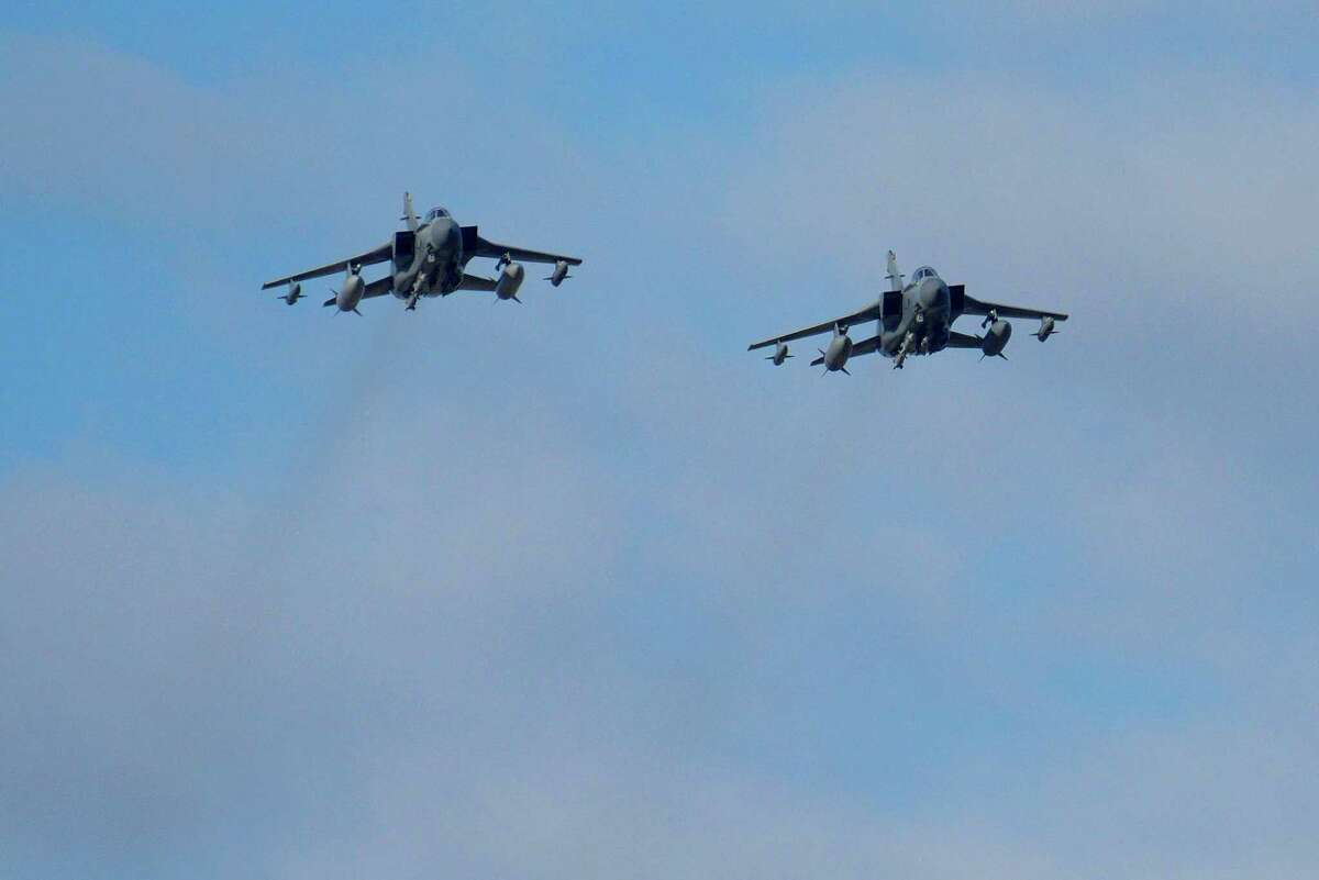Two British Tornados warplanes fly over the RAF Akrotiri, a British air base near costal city of Limassol, Cyprus, Thursday, Dec. 3, 2015, as they arrive from an airstrike against Islamic State group targets in Syria. British warplanes carried out airstrikes in Syria early Thursday, hours after Parliament voted to authorize air attacks against Islamic State group targets there.
