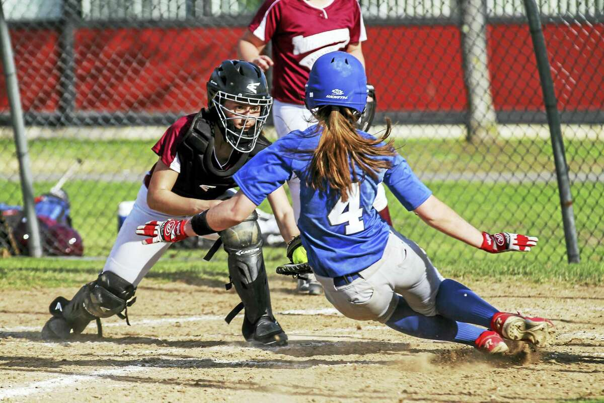 Photo by Marianne KillackeyTorrington catcher Cierra McGowan stops Southington's Janette Wadolowski at the plate after Wadolowski tried for her second straight home run at Torrington.