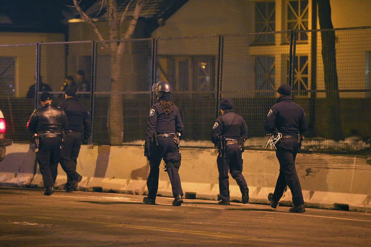 Minneapolis Police make their way around the 4th Precinct after they cleared the protestors and their encampment early, Thursday, Dec. 3, 2015, in Minneapolis. Demonstrators gathered at the site since the Nov. 16 death of 24-year-old Jamar Clark following a confrontation with police a day earlier.