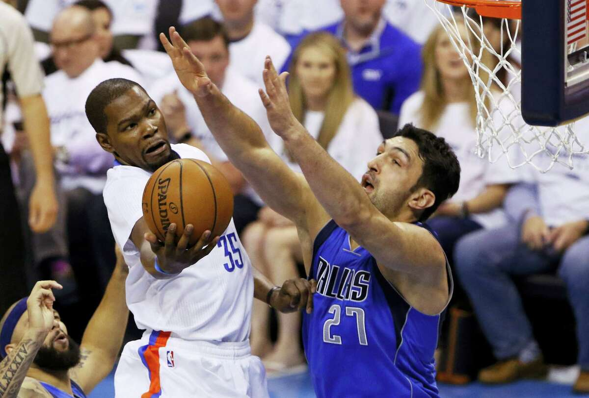 Oklahoma City Thunder forward Kevin Durant (35) goes to the basket as Dallas Mavericks center Zaza Pachulia (27) defends during the first half of Game 2 of a first-round NBA basketball playoff series Monday in Oklahoma City. The Mavs won 85-84 to tie the series.