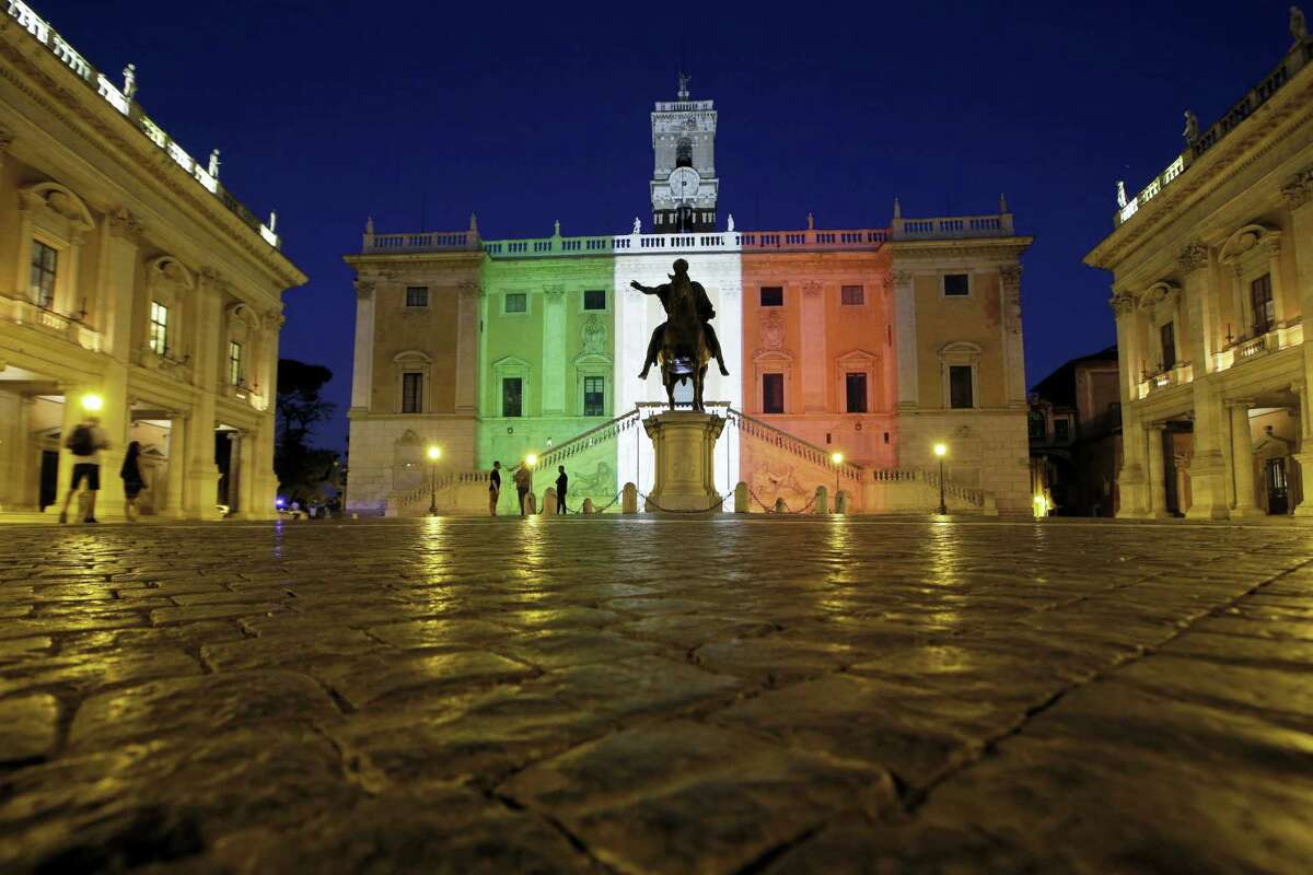 The facade of Rome's Campidoglio Capitol Hill is lit with the colors of the Italian flag, in Rome, Saturday, July 2, 2016. Italy's foreign minister said the bodies of nine Italians have been identified after a group of armed extremists stormed a restaurant in Bangladesh.