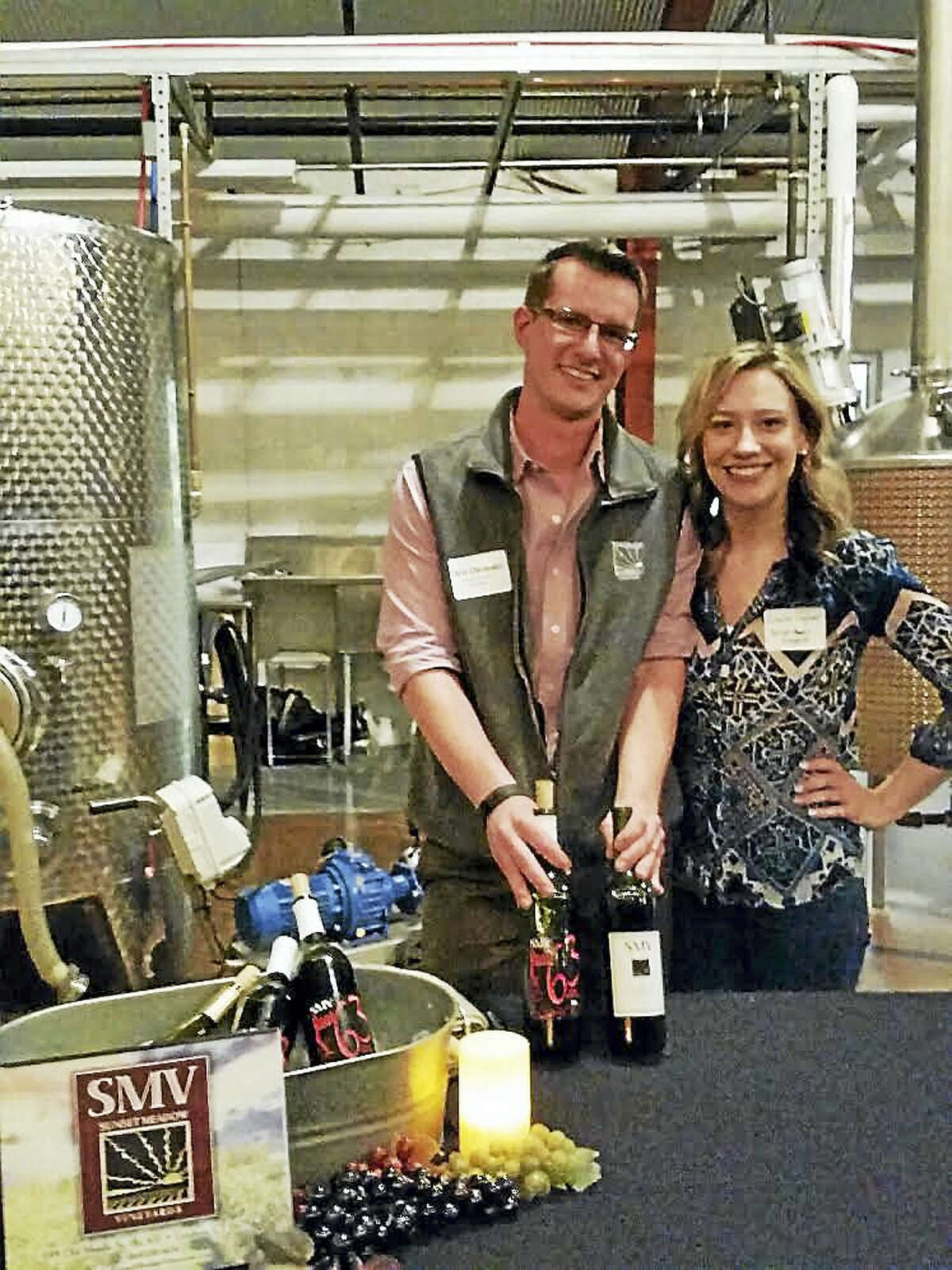 """Christopher Chichester and Emilia Jaguera of Sunset Meadow Vineyards of Goshen introduced about 100 visitors to their vintages at culture blog Unlocking Litchfield's """"First Birthday"""" party at Litchfield Distillery ,at 569 Bantam Rd., in Litchfield on Saturday evening. Activities included speeches from Ross as well as the 2003-season """"American Idol"""" contestant Kimberley Locke and etiquette lecturer Karen Thomas of Torrington. Photo by Noel Ambery"""