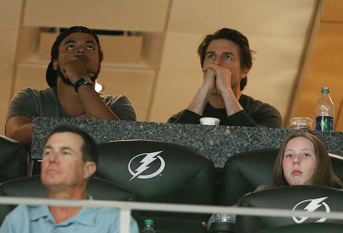 Actor Tom Cruise, top right, watches play between Connecticut and Maryland during the first half of the NCAA Women's Final Four tournament college basketball semifinal game on April 5, 2015, in Tampa, Fla.