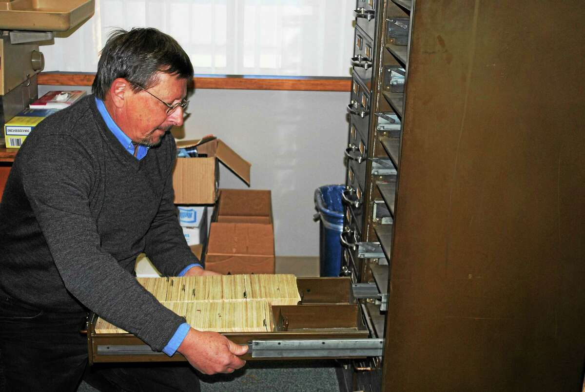 The Register Citizen Thursday donated two file cabinets with index cards containing information about people in Torrington from the 1890s to about 1983 to the Torrington Historical Society so they can be preserved and made available to the public. Here, Torrington Historical Society President Mark McEachern carefully removes the filing cabinet drawers to start packing up the files.