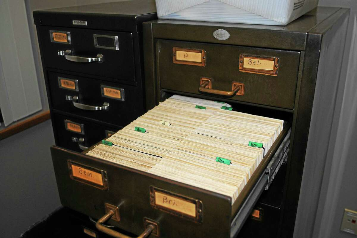 The Register Citizen Thursday donated two file cabinets with index cards containing information about people in Torrington from the 1890s to about 1983 to the Torrington Historical Society so they can be preserved and made available to the public.